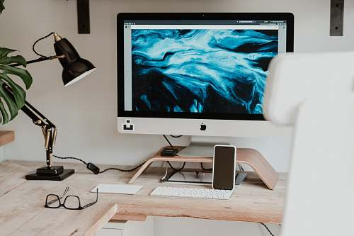 electronics silver imac on brown wooden desk monitor