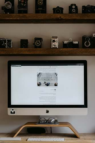 electronics silver imac on brown wooden table monitor