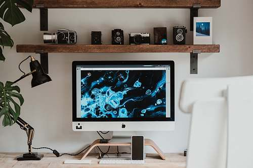 indoors silver imac on brown wooden table interior design