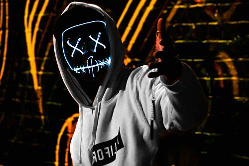 apparel man wearing white California pullover hoodie and LED mask clothing