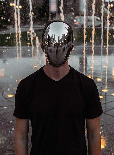 human man covering his face standing person