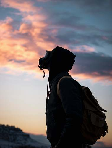 human person wearing gas mask while looking up person