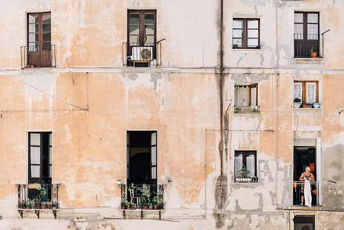city minimalist photography of open windows and doors of building terraces italy