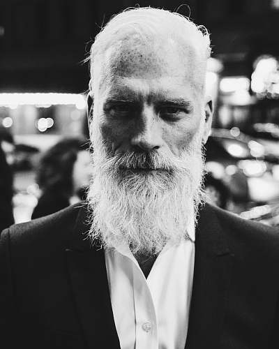 beard grayscale photo of bearded man white hair