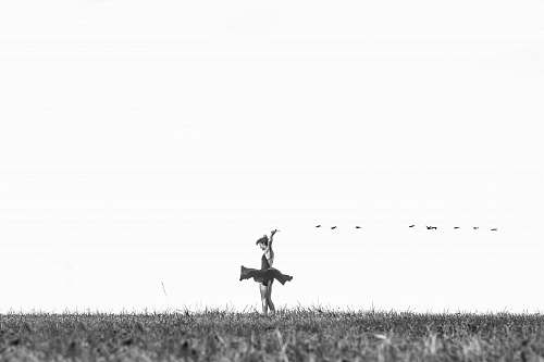 wallpaper greyscale photo of woman standing on grass field dance