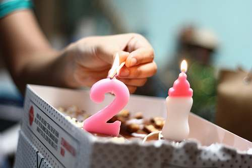 photo candle person lighting number 2 candle birthday cake free for commercial use images
