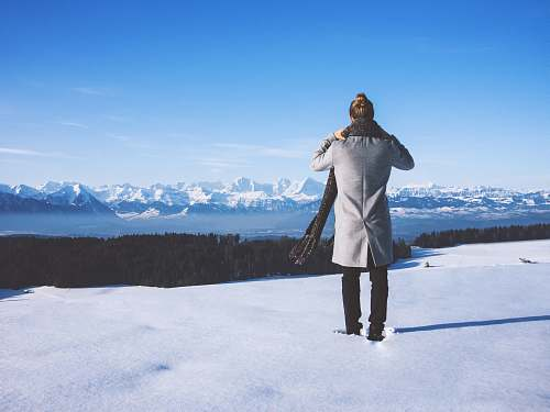 apparel woman standing near trees and body of water \ switzerland