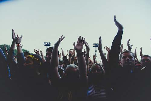 audience photography of people gathering near outdoor during daytime rock