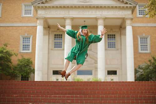 photo human woman wearing mortarboard jumping on staris person free for commercial use images