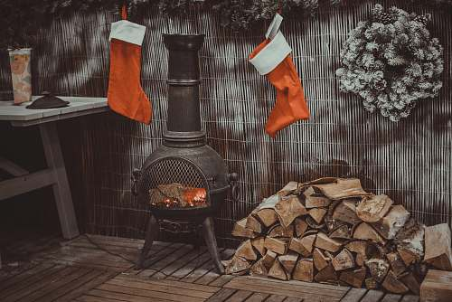 symbol firewood in black chiminea fireplace