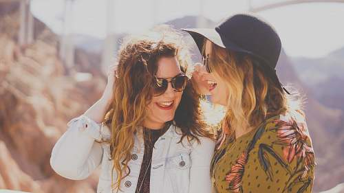 woman two women smiling while wearing sunglasses people