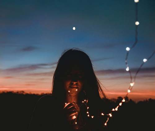 photo people woman holding gold string lights person free for commercial use images