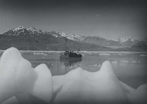 nature grayscale photo of boat near mountain grey
