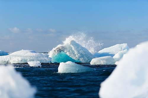 photo winter icebergs floating on body of water during daytime iceberg free for commercial use images