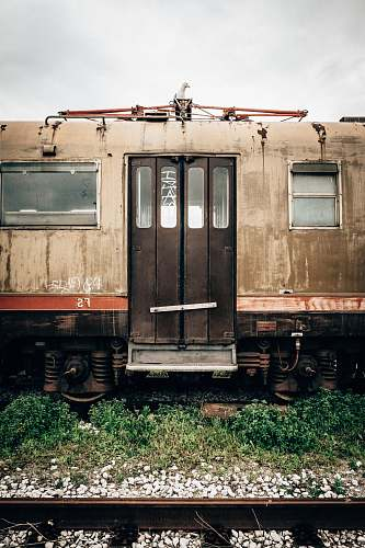 passenger car brown and black abandoned train on rail during daytime trieste