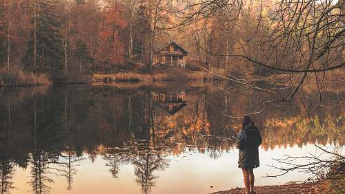 lake girl standing near to body of water reflection