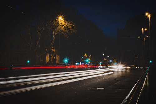photo road time lapse photography of vehicle passing on road at night night free for commercial use images