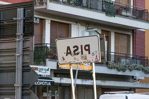 sign white PISA road signage near building pisa