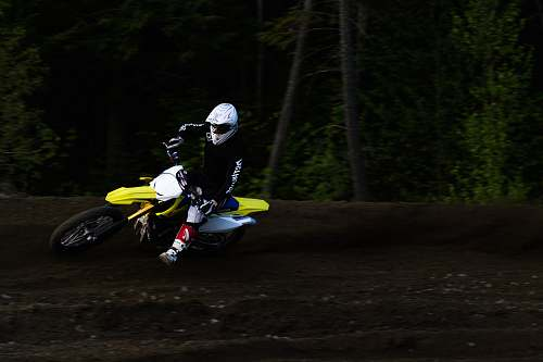 photo human man ridding yellow and white motocross dirt bike back free for commercial use images