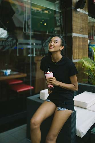 photo person woman holding shake cup woman free for commercial use images