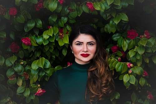 woman woman standing near green tree brunette