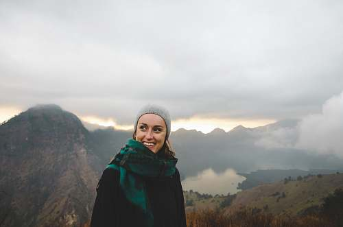 people woman wearing green scarf smiling female