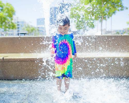 photo person boy standing on water kid free for commercial use images