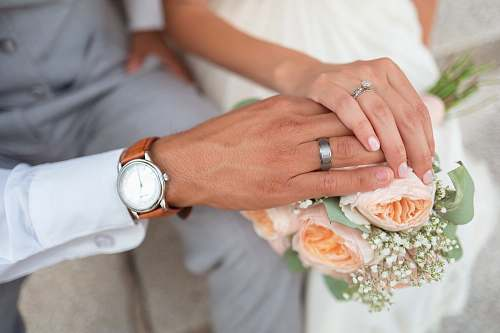 hands man and woman holding hands flowers
