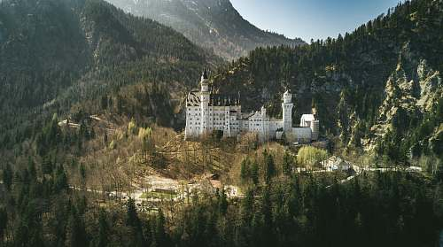 building landscape photo of castle near the mountain nature