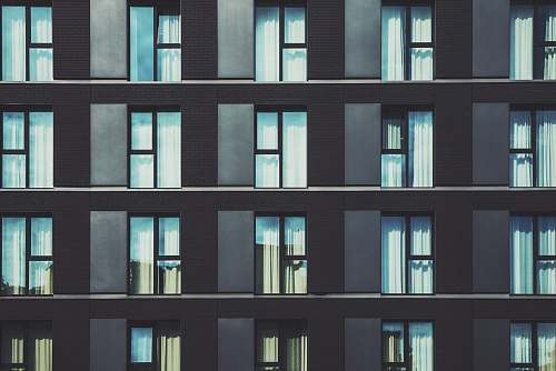 germany gray high-rise building with glass windows building