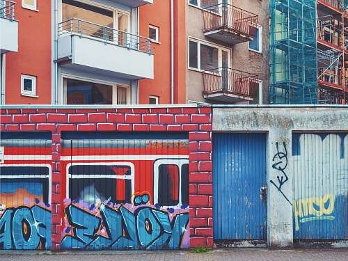 germany wall with murals during day graffiti