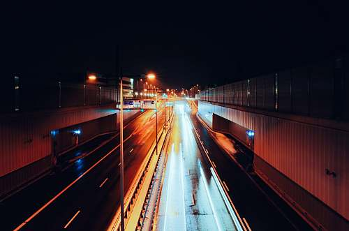 highway empty road with streaks of light during nighttime time lapse photography munich