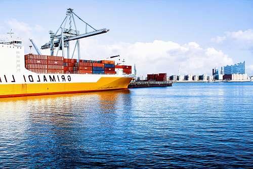 boat white and orange cargo ship with metal lifting equipment hamburg
