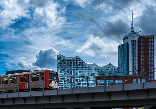 germany train running on rail near buildings during daytime building