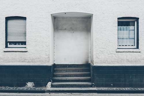 grey close up photo of white and black concrete building's entrance satzvey