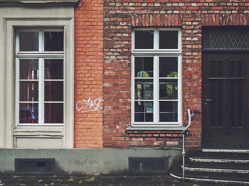 brick closed brown wooden door köln