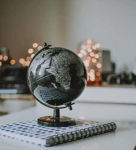 astronomy black and gray desk globe on notebook outer space
