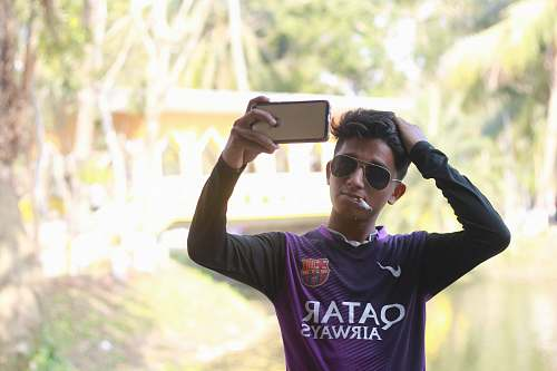 photo accessory man wearing purple Nike Qatar Airways jersey shirt sunglasses free for commercial use images