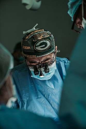 clothing doctor wearing Green Bay Packers hat helmet