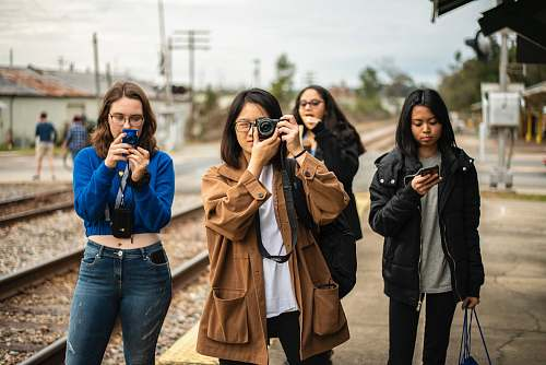 photo clothing four women standing by the railroad denim free for commercial use images