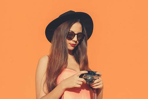 photo clothing woman holding camera hat free for commercial use images