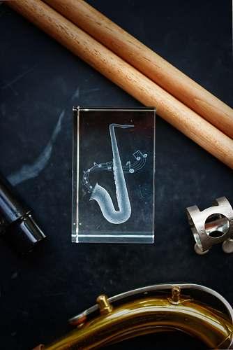 tool gray saxophone icon text
