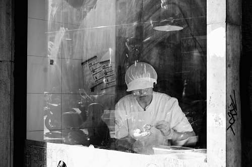 apparel grayscale photography of person working inside room clothing
