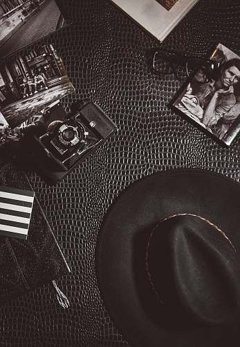 hat camera beside black hat photo