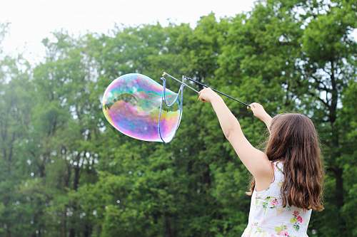 people girl making bubbles during daytime bubble