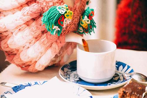 photo saucer selective focus photography of person pouring teacup tea free for commercial use images