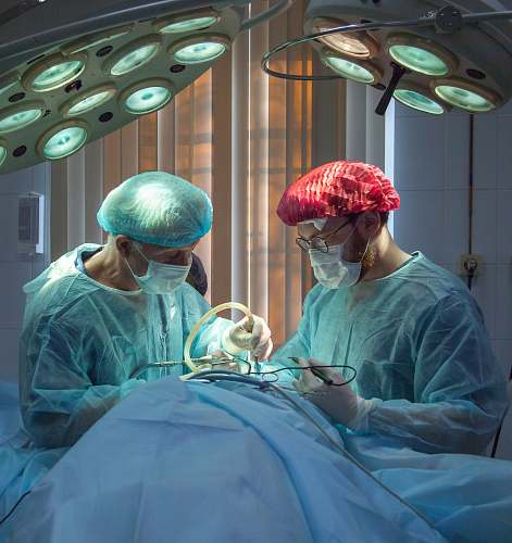 clinic two men wearing blue lab coats hospital