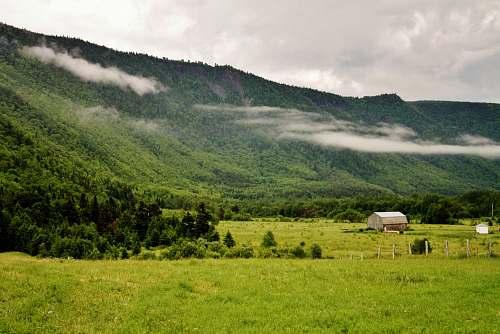 farm brown house near mountain peak pasture