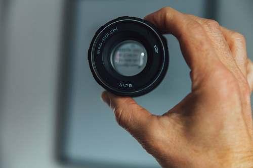 lens person holding camera lens camera