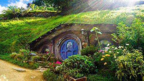 cottage underground house covered with green grass and plants outdoors